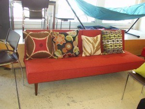 Decorative pillows shown  brown/red shield, Erte charcoal, Botanical wheat, ZigZag green.