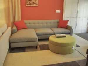 """""""Porter"""" 2 piece sectional with a movable chaise from left to right. Shown in Norden graphite fabric and wood legs 91""""W x63""""E x 31""""H $3887 or floor sample priced at $2795. Made in Canada in about 10 weeks."""